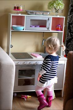 Sienna's new kitchen! Took a little wine and patience but was fun to make :) Ikea Hack - Ikea Duktig Kitchen. Martha Stewart Polished Silver metallic paint for oven and microwave/cabinets. White and Martha Stewart ballet slipper pink paint for rest. Home Depot hardware.