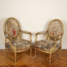Pair Louis XVI carved and gilded wood   fauteuils, upholstered in Aubusson tapestry of the same period.