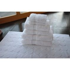 Seven-Piece 100% Cotton Towels and Bathmat Set Indulge in the lap ...