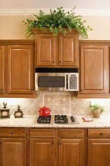 ginger maple kitchen cabinets kraftmaid glaze cabinets with granite countertops 15800