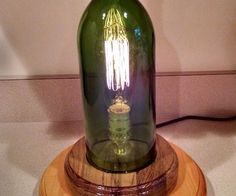 This instructable shows you how to make a vintage Edison bulb lamp using a wine bottle. A note on the wine bottle: This is a large wine bottle with a ...