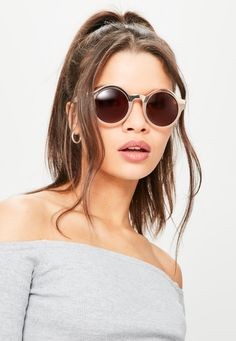 elevate your style game wearing these super sleek sunglasses in a nude hue - featuring a rounded design and half metal details.