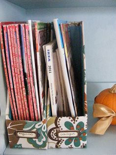 DIY Magazine File - made with pieces of cardboard taped together and covered in fabric.  Cute!