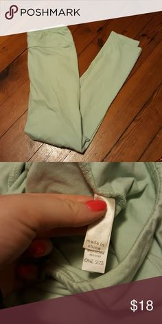 Light seafoam green lularoe leggings Worn twice, made in China. Solid leggings no heather or anything what so ever. They are are in the lighter side LuLaRoe Pants Leggings
