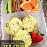 Bacon Mushroom Egg Muffins for Office Lunch Served in an Easylunchboxes container, this lunch contains:  3 bacon-mushroom egg muffins (pack when cooled completely) 1 strawberry Sliced Cara Cara Oranges Gluten-free pretzel sticks and Snap Pea Crisps