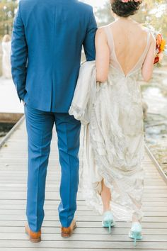 Bright bridesmaids, a colorful bouquet and a gorgeous beaded wedding dress.This botanical garden wedding has us swooning!
