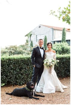 Bride and groom with their dog at Summerour Studio in Atlanta. Wedding dress by Reem Acra, bouquet by Victory Blooms with ribbon by Silk & Willow. Image by Rustic White Photography.