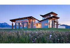 Exterior view of the living area.  Contemporary, modern timber frame mountain home shot at twilight.  Corrugated metal siding, shed roofs, a...