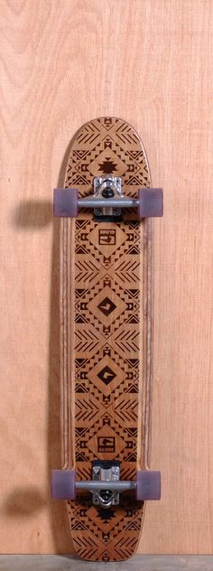 """The Globe Plank Longboard Complete is designed for Cruising and Carving. Ships fully assembled and ready to skate!  Function: Cruising, Carving  Features: Wood Burned Artwork, Routed Traction Channels  Material: 9 Ply Maple  Length: 37.75""""  Width: 8""""  Wheelbase: 21.875""""  Thickness: 1/2""""  Hole Pattern: New School  Grip: Routed Traction Channels"""