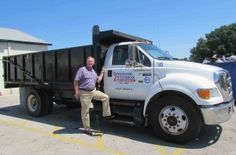 President Rob Springer poses for the Bartow Ford Buzz article on our company!