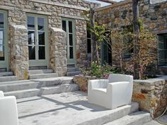 Spending your vacation in a museum of Greek handcrafts is a rare privilege. Mandri is the last creation of Giorgos Zafiriou, the architect who interpreted the Mediterranean Garden, Courtyards, Greek Islands, Beautiful Homes, Stone Patios, Porch, Summer Houses, Exterior, Windows