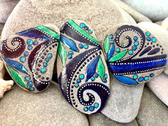 A personal favorite from my Etsy shop https://www.etsy.com/listing/482671628/blue-jungle-magnet-set-painted-rock