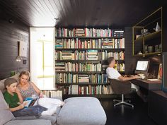 """In the den, Lara and Cal read a Hardy Boys mystery on the Flexform Groundpiece sofa by Antonio Citterio while Chris works in his """"office."""" The cozy room where the family spends much of their time once housed the kitchen."""