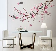 Tree branch wall decal with blossoms and birds.