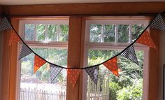 Want to get a jump start on your Halloween decor? This reversible fabric banner made in Halloween colors is perfect for party decor, seasonal family room or kitchen usage, or even an office space. With black and white gingham checks and orange and white polka dots, its all very kid friendly! And the gingham makes it just a bit cottage chic. . . Since it is securely sewn from machine washable fabrics, you can also let it blow in the breeze during an outdoor event. The bunting includes 11…