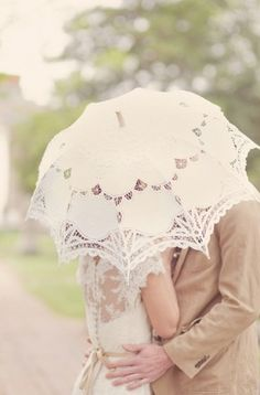 kissing under a parasol