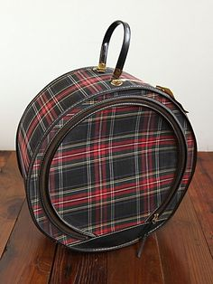 We'd love to hop on a train with this! Vintage Round Plaid Suitcase. http://www.freepeople.com/vintage-loves-tartan-traveler/vintage-round-plaid-suitcase/