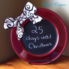 Christmas Countdown Chalkboard. Charger from Walmart, adhesive chalk board paper from Michaels, ribbon for bow from Hobby Lobby.