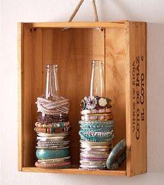 Organize bracelets on glass bottles.