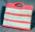 Work up a fun and textured bag using clusters - and lots of them! Great for the beach, park, or any outing. Work in two colors, a sol...