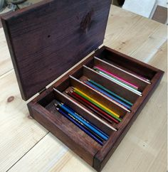 (INTRODUCTORY PRICE) Solid wood colored pencil storage case. Has 4 removable dividers creating up to 5 separate compartments. Stained in red mahogany a made of solid 3/4 wood. Has a hinged lid to keep closed while in storage . Overall outside dimensions 14 3/4 width 9 1/2 depth 3 1/4 height Overall inside dimensions 13 1/4 width 8 depth 1 3/4 height Dividers are spaced at approx 2 1/4