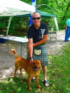 North Georgia (USA) Highlander with his dog at Blairesville Scottish Festival & Highland Games.