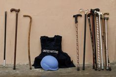 The walking sticks commonly carried by Somali elders and the protective gear worn by the United Nations staff rest against the wall outside a conference hall where a meeting to select members of the country's new parliament is taking place in the capital Mogadishu, Somalia.