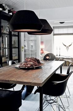 a cool rustic dining table and eames chairs. I find the pendants too chunky for my taste, but overall it has a modern look with a rustic twist which I like