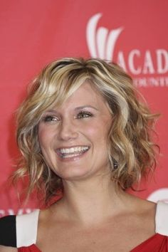 23 Great Short Curly Hairstyles For Women 2013. Lots of cute styles, however I'm not sure I don't want to be able to pin my hair up again.