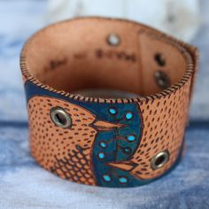 Wood burned & painted leather cuff with metal snap closure | © geninne d. zlatkis 2013
