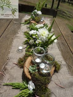 rustic outdoor reception using hessian table runners, mason jar candles, succulents, moss, amaranthus and crisp white flowers. Peppers guest house, pokolbin www.jademcintoshflowers.com.au