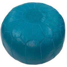 """Brimming with cosmopolitan appeal, this handcrafted leather pouf showcases embroidered Moroccan-inspired stitching and a vibrant blue hue.    Product: Pouf  Construction Material: Leather cover and polyfiber fill Color: Blue   Features: handcrafted Embroidered Moroccan-inspired stitching  Dimensions: 14"""" H x 20"""" Diameter"""
