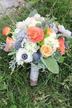 Anemones, blue thistle, and free spirit roses, orange ranunculus, and nectarine roses combine beautifully. www.newinbloom.com