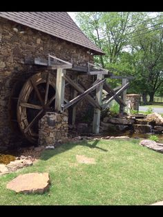 A Water Garden by an old stone mill house with a water wheel fountain feature. Water Wheels, Front Entrances, Future Goals, Old Stone, Water Garden, Ponds, Water Features, Fountain, Garden Ideas