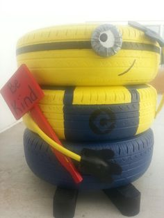 Minions recycled garden decor made from old car tires - yard art - school garden project - image only Recycled Garden, Recycled Crafts, Minions, Tire Craft, Tire Garden, Tire Planters, Tyres Recycle, Yard Art, Garden Projects