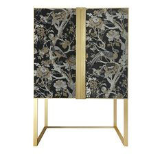 This magnificent cabinet was created to contain beverages, glasses, and table linens and it will enrich any dining room, thanks to its exquisite craftsmanship and the elegance of its contemporary design. Entirely made with artisanal methods, its structure features an open brushed brass base supporting the body with doors in wood covered with a precious silk jacquard fabric adorned with a motif of birds and branches in gold and silver, silk