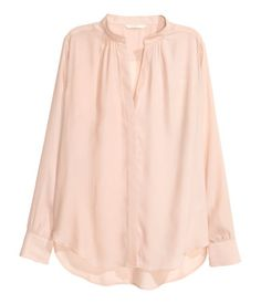 Powder pink. Long-sleeved blouse in airy woven fabric. V-neck, concealed buttons…