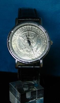 SOLD $67 Morgan Silver Dollar Wrist Watch. #buyrarestuff  This timepiece features a U.S. Morgan silver dollar reproduction into its watchface. George T. Morgan, the coin was minted from 1878 to 1921. With three hands, the timepiece employs the reverse side of the coin as the watchface, featuring a bald eagle, the mintmark below the wreath, and a tiny, sideways 'M' etched into the left loop of the wreath's ribbon--the first U.S. coin to use the designer's initial on both sides.