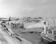 Wrecked pontoon causeway of one of the 'Mulberry' artificial harbors, following the storm of 19-22 June 1944, off Normandy, 23 June 1944.
