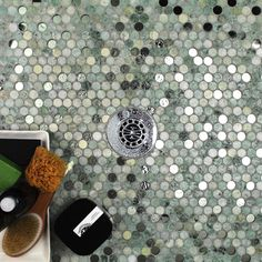 Beautiful combination of marble and glass penny round mosaics. Perfect for a…
