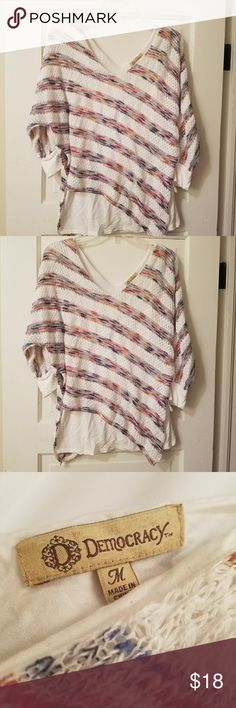 Multi-Color Diagonal Striped Lace Over Top Democracy clothing company. Size medium. Asymmetrical. Multicolored striped. Lace over. Excellent condition. No rips. No stains. No tears. V-neck in the front and in the back. Bought from Dillards. Barely worn. No signs of wear. Clean and from a smoke-free home. Very trendy. Democracy Tops Blouses