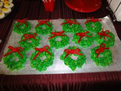 marshmallow cornflake wreaths - just like rice krispies treats but with cornflakes and green food coloring. shape them to look like wreaths and add twizzlers for the bow. Don't forget to grease your fingers while shaping or they'll stick like crazy!