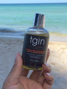 Après ☀️ TGIN Replenishing Hair & Body Serum Is the perfect beach companion.    NOURISHES HAIR, FACE AND BODY with argan oil, coconut oil, jojoba oil and vitamin E for smooth hair and skin.     #apressoleil #aftersun #hairserum #skinserum #plantbased #handmadebeauty #tgin #arganoil #coconutoil #jojobaoil #vitamine #greenbeauty #greenbeautyblogger #femaleentrepreneur #beach #shopify #shopifypicks