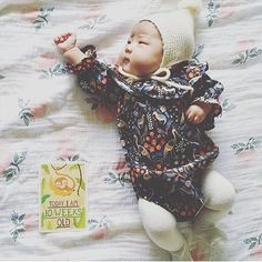 Dem cheeks!! Love this 10 week old baby doll in our dark tapestry romper. We only have 1 more of this romper left!