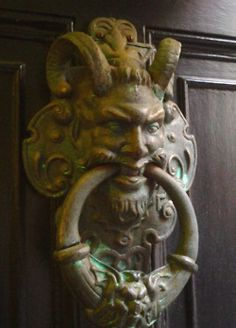 On the knocker a monster with the face of a man leered at me, daring me to lift its heavy ring and let it fall.