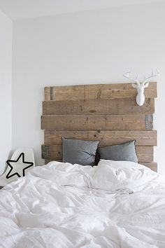 My dad must have some wood around that can be used to make a headboard like this...we already have the deer head!