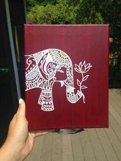 Red canvas white elephant