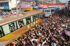 Students taking the bus to their exam in Liu'an, Anhui province. Thousands of family and friends crowded the streets in support as they left for the test.
