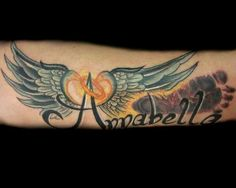 Child's footprint tattoo with her name and angel wings