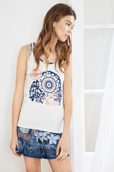 Desigual white sleeveless T-shirt with a floral print in blue. Team with our matching bottoms! Discover Desigual Living collection!